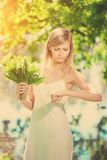 Young artistic woman  with flowers outdoors Stock Photos