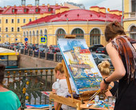 Young artists draw river landscape on plenere in Stock Photos