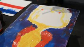 Young artists paint on picture stock footage