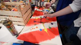 Young artists paint on picture while the performance in gallery Mistetskiy Arsenal stock video