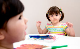 Young artists painting on canvas Royalty Free Stock Image