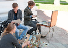 Young artists painting near church in Kiev Ukraine Stock Image