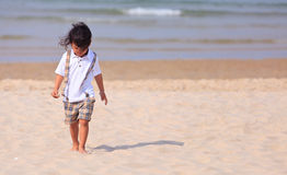 Young Asain boy on beach Royalty Free Stock Photo