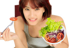Young asain woman with a bowl of vegetable salad Royalty Free Stock Photography
