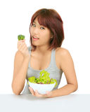 Young asain woman with a bowl of vegetable salad Stock Images