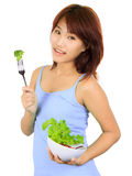 Young asain woman with a bowl of vegetable salad Stock Image