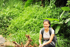 Woman hiker rest at rainforest Stock Photo