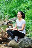 Woman meditation in jungle Stock Photo