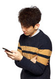 Young asia man texting on mobilephone Stock Image