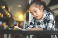 Young asia reading book in library , University girl , education concept.  royalty free stock photos