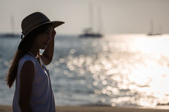 Young asia woman with hat on beach Stock Image