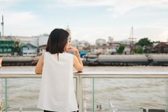 Young woman stand alone on riverside and she looking scenery vie Stock Images