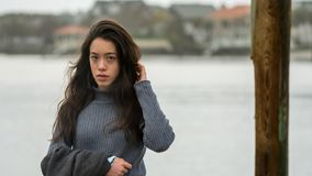 Young Asian-American at North Carolina Beach in winter stock image