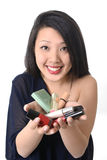 Young asian american woman showing make up set Stock Photography