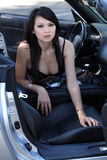 Young Asian American woman sitting in car Stock Photo