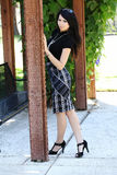 Young Asian American Woman stand outdoors skirt Royalty Free Stock Image