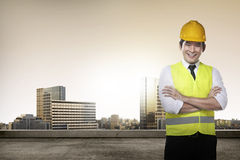 Young asian architect. Young succesful asian architect over city background royalty free stock photo