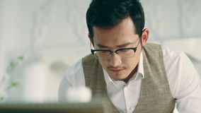 Young asian architect working on an architecture design. With serious facial expression stock footage