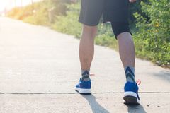 Young asian athlete man tying running shoes in front house,male. Runner ready for jogging on the road outside,wellness and sport concepts Stock Photo