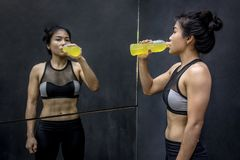 Young Asian athlete woman drinking sport drink Royalty Free Stock Photo