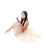 Young Asian Ballerina Tying Her Ballet Pointe Shoes Stock Photography