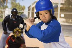 Young Asian Baseball Player With Bat Royalty Free Stock Photos