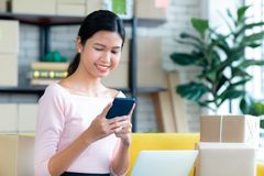 Young Asian beautiful girl is happy smiling to shopping online w royalty free stock image