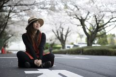 Young Asian beautiful woman is enjoy traveling in Japan royalty free stock images