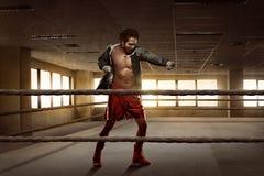 Young asian boxer man workout punching Stock Photo