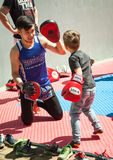 Young Asian boxer training a small kid in Muay Thai Stock Photo