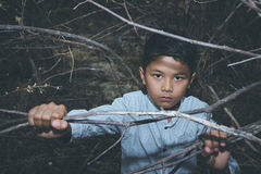 Young Asian boy alone stock images