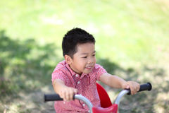 Young asian boy on a bike Royalty Free Stock Images