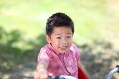 Young asian boy on a bike Stock Photos
