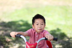 Young asian boy on a bike Stock Photo
