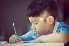 Young asian boy doing his homework Stock Photo