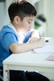 Young asian boy doing his homework Stock Image