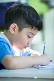 Young asian boy doing his homework Royalty Free Stock Photography