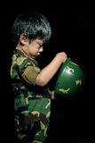 Young asian boy dressed like a soldier Stock Images