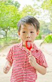 Young asian boy eating ice-cream Stock Image