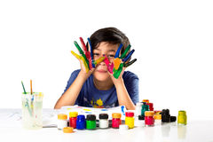 Young asian boy with hands in paint Stock Image