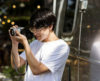 Young asian boy holiday leisure taking photo Stock Images
