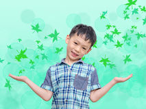 Young Asian boy with leaves fall Stock Photos