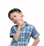 Young Asian boy looks serious with pencil Stock Image