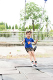 young asian boy play a iron chain swinging Royalty Free Stock Image