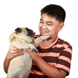 Young asian boy playing with his dog. Isolated over white Stock Photo