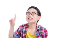Boy pointing up and smiles over white background royalty free stock photo