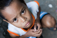 Young Asian boy portrait. Portrait of a young Asian boy from poverty-stricken area. Natural light, Manila, Philippines Royalty Free Stock Photos