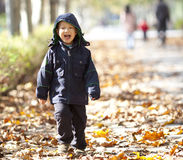 Young asian boy  running in the park Stock Photography