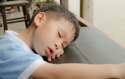 Young asian boy sleeping Royalty Free Stock Photos