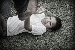 Young Asian boy suffering physical abuse Royalty Free Stock Photo